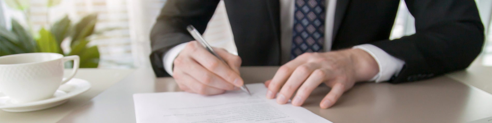 Insurance agent signing contracts