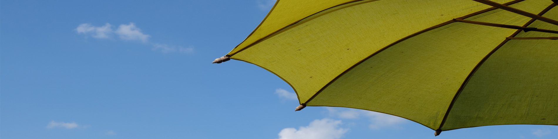 Umbrella against blue sky