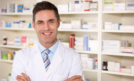 Medical Professional standing in front of medical supplies