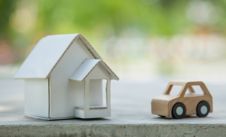 miniature cardboard house and car